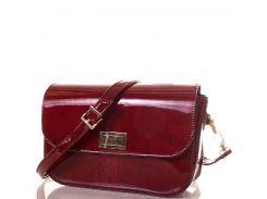 Неотразимая женская сумочка модного мраморного темно-красного цвета с золотистой фурнитурой
